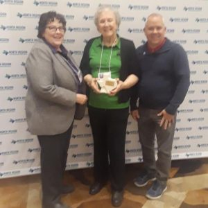 Margaret Young receives Advocate of the Year Award at TRAPS North Region luncheon.